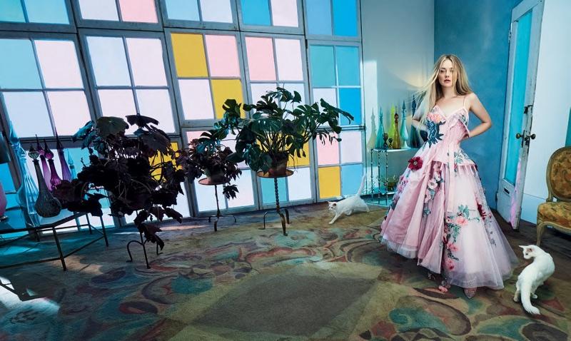Looking pretty in pink, Dakota Fanning poses in Alexander McQueen gown