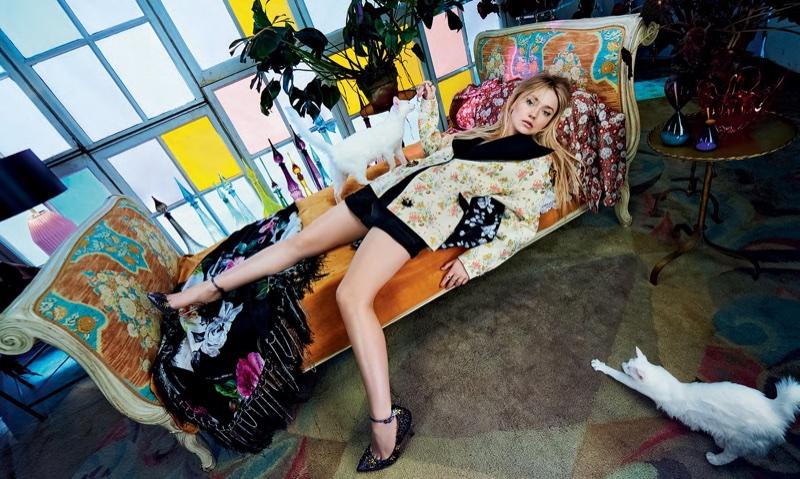 Laying down, Dakota Fanning poses in floral print
