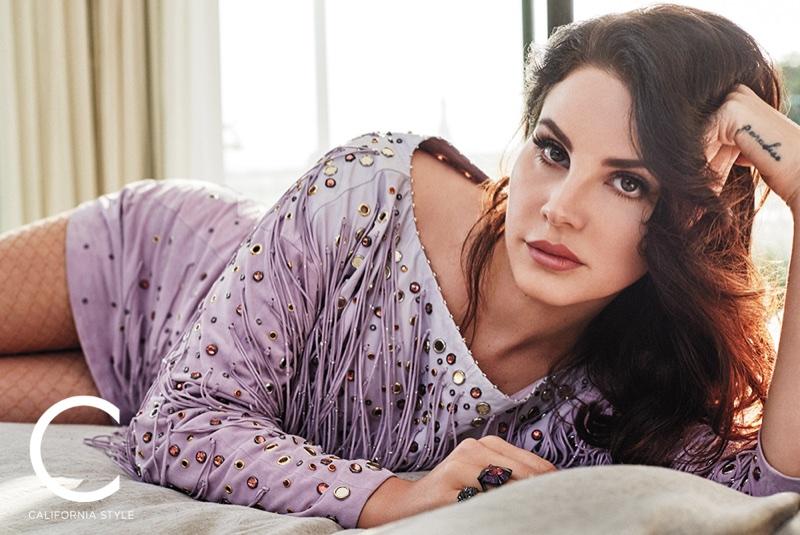 Posing in bed, Lana Del Rey wears Bottega Veneta dress