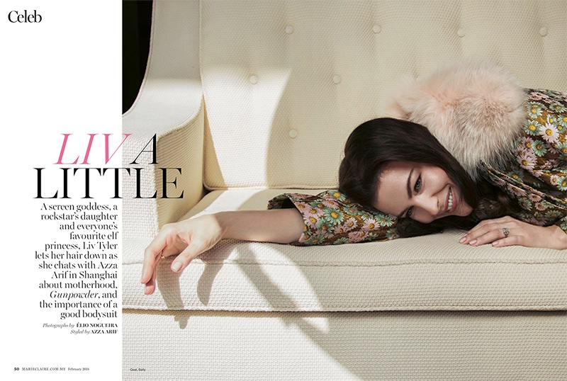 Flashing a smile, Liv Tyler wears a floral embroidered coat from Bally