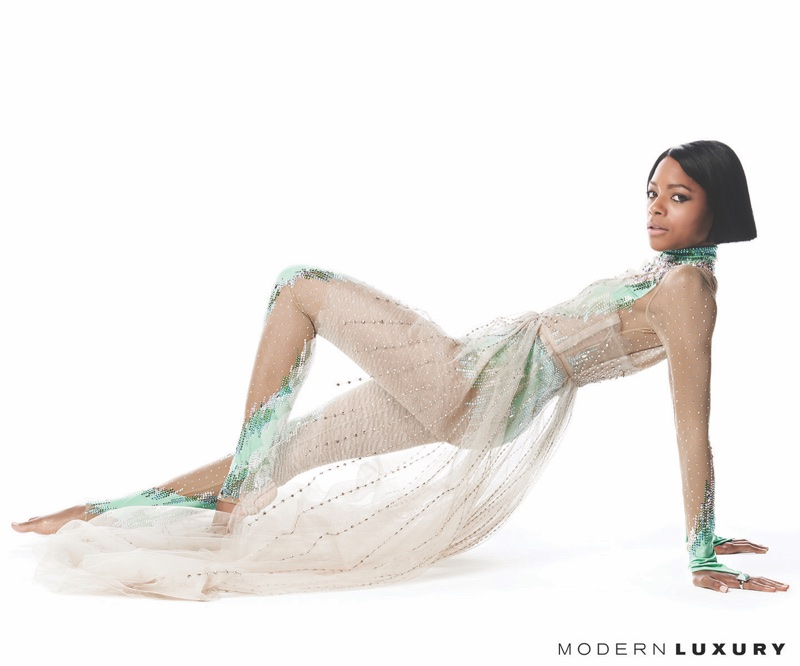 Striking a pose, Naomie Harris wears Gucci soft tulle gown and embroidered jumpsuit