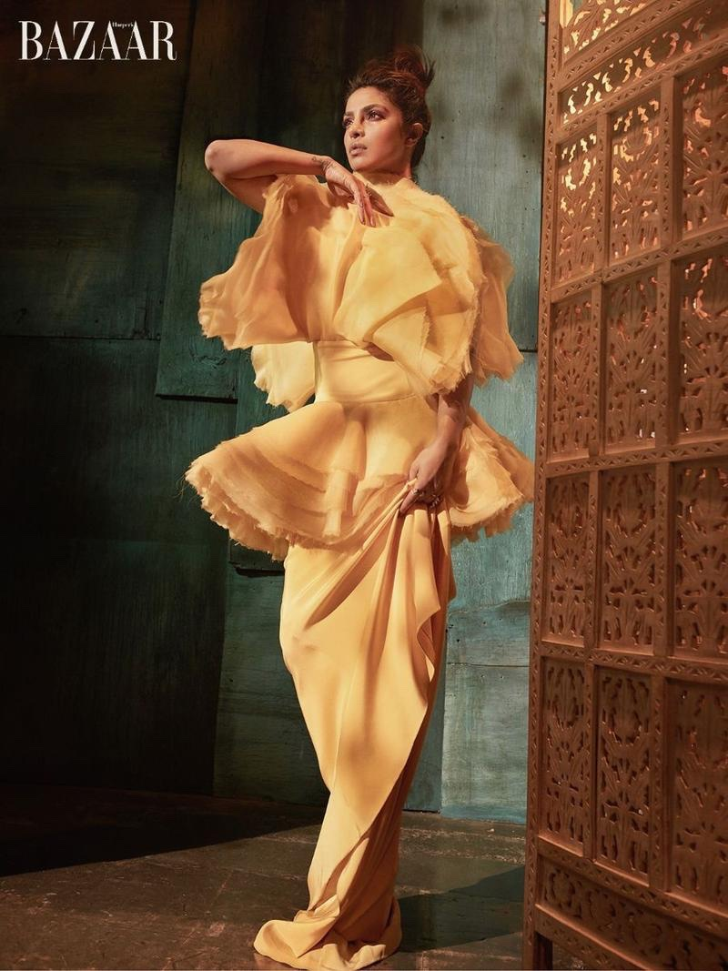 Actress Priyanka Chopra poses in yellow gown