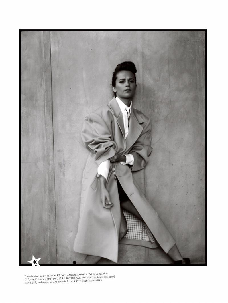 Actress Alicia Vikander wears Maison Margiela coat, Gant shirt and The Kooples skirt