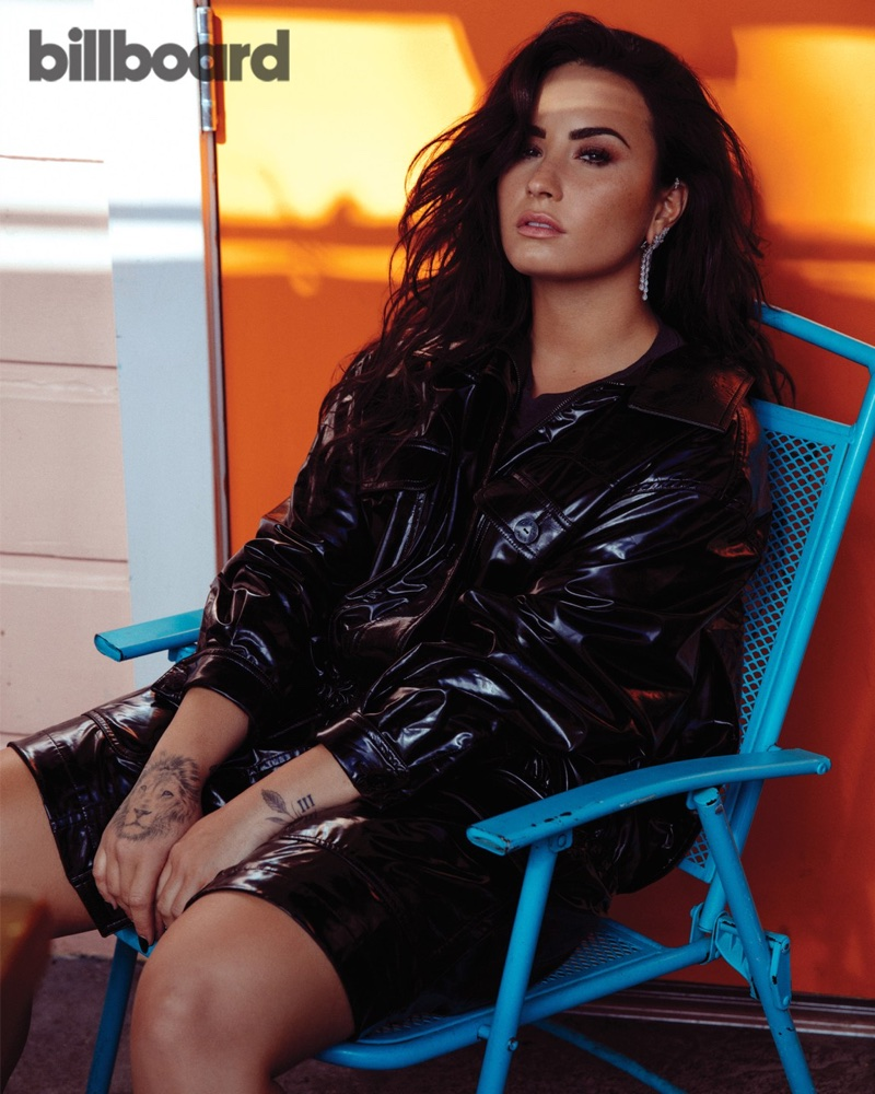 Singer Demi Lovato shows off her tattoos