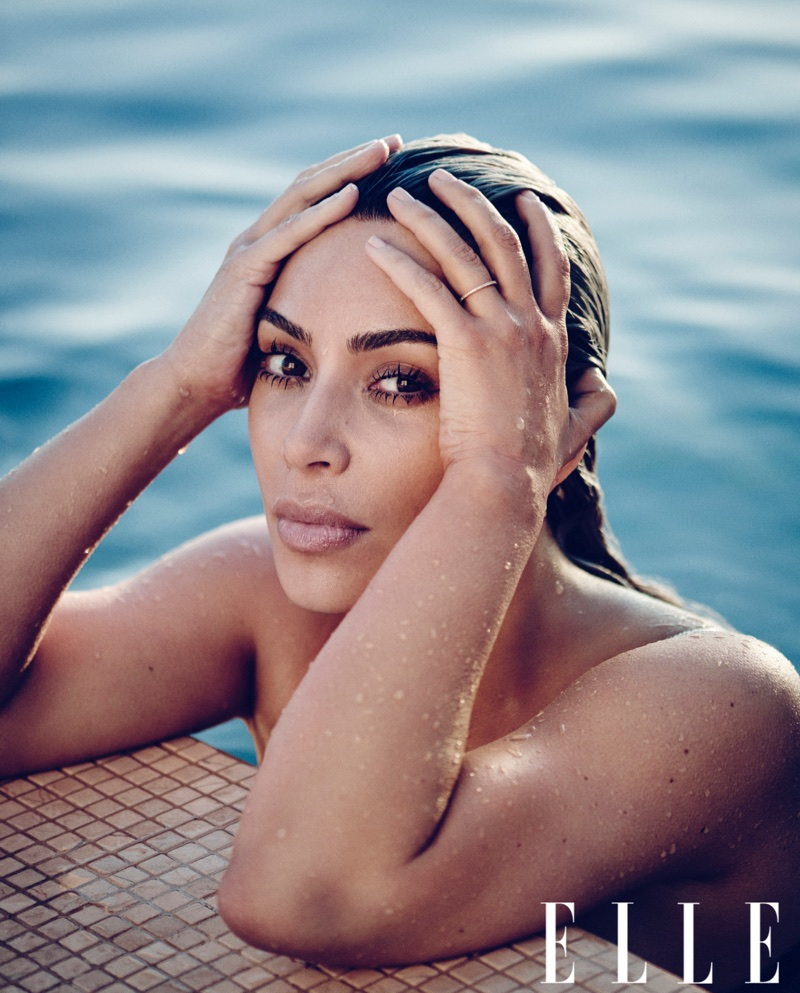 Posing in a pool, Kim Kardashian poses for ELLE