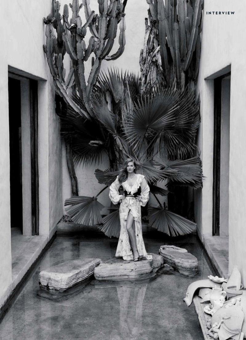 Isla Fisher poses in Johanna Ortiz dress