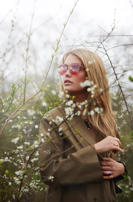 Posing outdoors, Kitty Spencer wears Bulgari sunglasses and jewelry