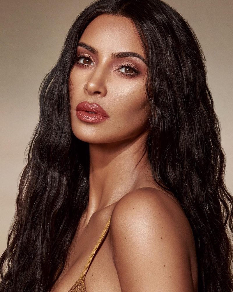 Wearing KKW Beauty Crème Lipstick in Peach 4, Kim Kardashian models the Classic Collection