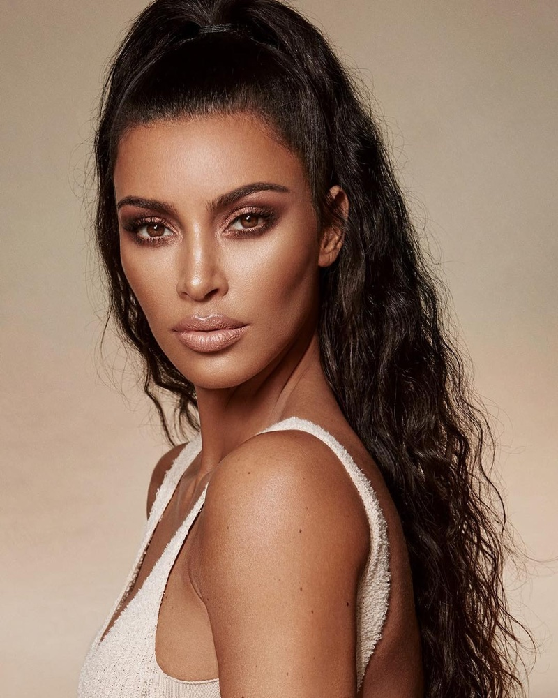 Showing off a bronzed look, Kim Kardashian fronts KKW Beauty Classic Collection campaign