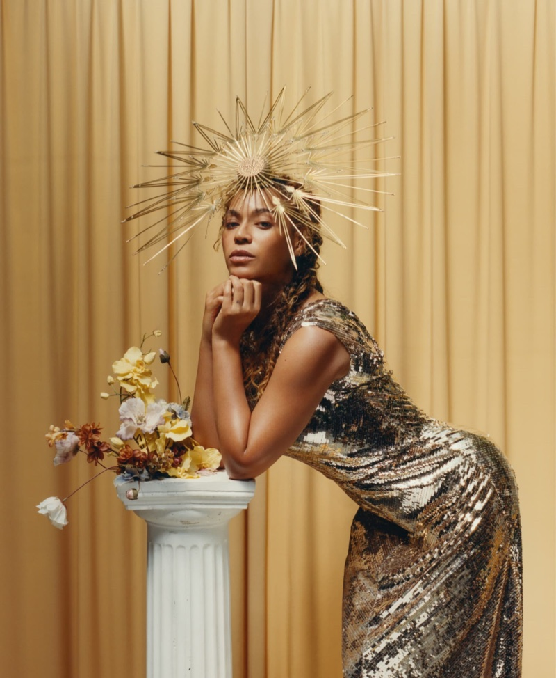 Beyonce poses in Valentino dress and Philip Treacy London hat