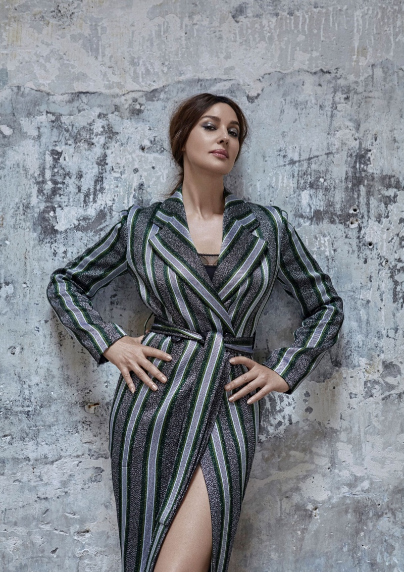Striking a pose, Monica Bellucci wears Emporio Armani coat and Eres bodysuit