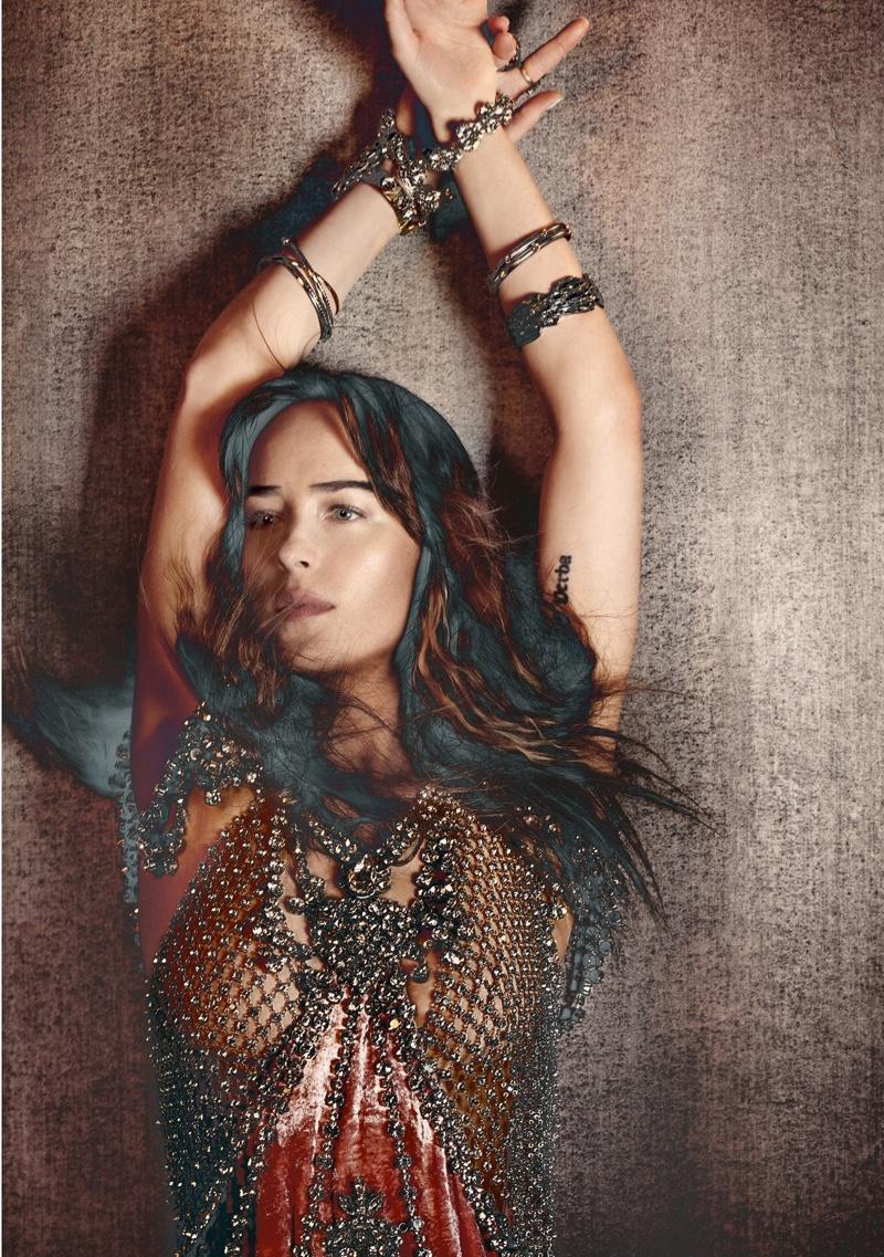 Actress Dakota Johnson poses in chain adorned dress