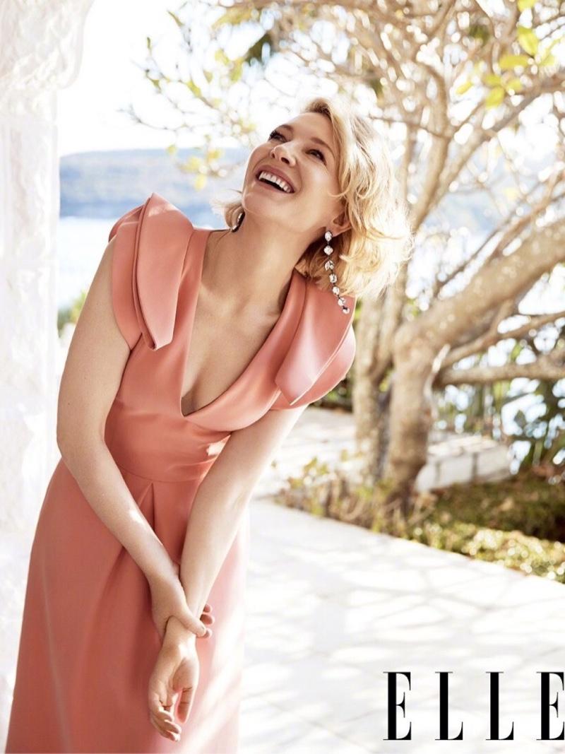 Flashing a smile, Cate Blanchett wears peach Giorgio Armani dress