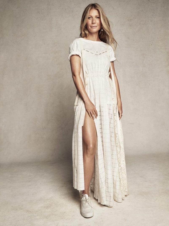 Dressed in white, Gwyneth Paltrow wears Loewe dress, Gap t-shirt and Filippa K sneakers