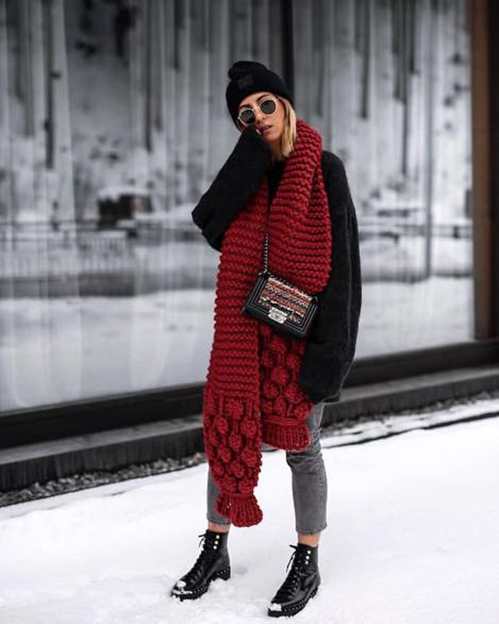 The street staples you need to look cool this season oversized scarf black sweater and gray jeans