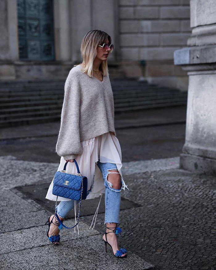 How to Get Noticed by Street Style Photographers During The Fashion Month ripped pants, gray sweater and dress
