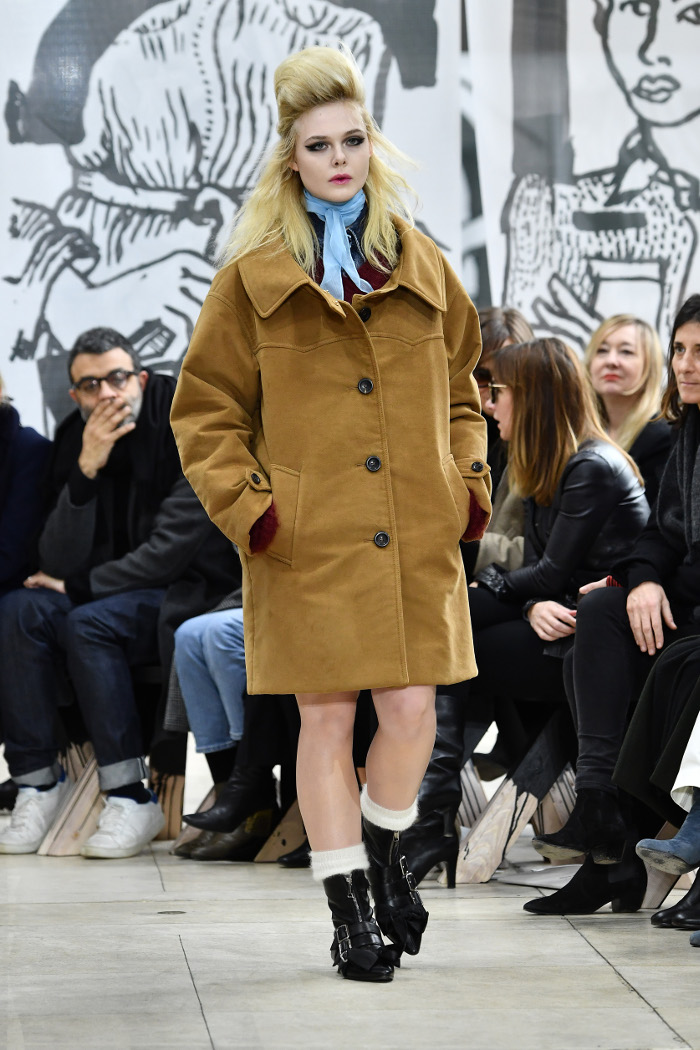 Elle Fanning Made Her Runway Debut at PFW Elle Fanning in an oversized camel coat