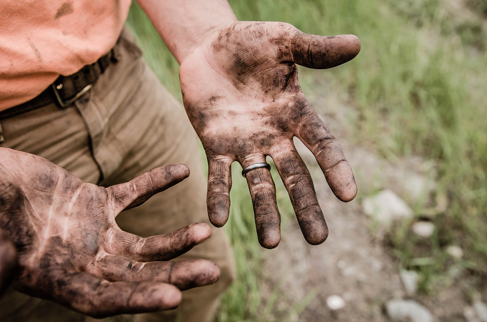 A pair of dirty hands from hard work.