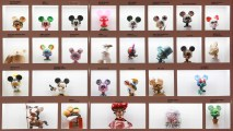 4. A selection of the Mickey 100 miniature statues in a wall display from the pop-up store
