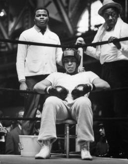 Professional Boxer Cassius Clay (C) preparing to give a boxing demonstration at a Moslem Supremacist Rally, Chicago, Illinois, March 1, 1965. (Photo by Frank Dandridge/The LIFE Images Collection/Getty Images)