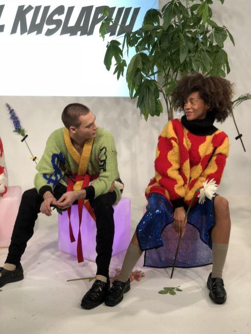 Kristel Kuslapuu FW18 Presentation at London Fashion Week 2 models chatting on stage