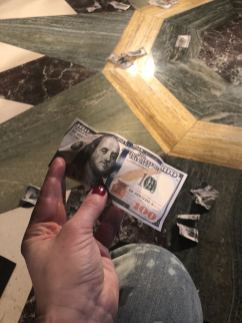 Fake money thrown on to the runway by models at Fortie Label's FW18 show at London Fashion Week