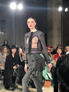 STARSICA FW18 LONDON FASHION WEEK a model in an open front suit with her breasts visible