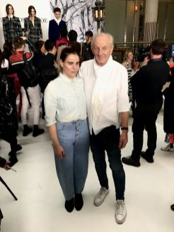 An image of Pixie Tenenbaum and Paul costelloe posing for the press at the Paul Costelloe FW18 show at London Fashion Week