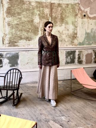 Merchant Archive FW18 LFW a model wears pale pink wide leg trousers with a dab dot paint effect jacket