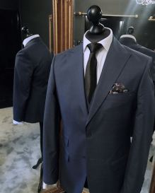 An image of a suit jacket tailored by Duke Ata Bespoke & on display at the launch of the Duke Ata Bespoke Clubhouse