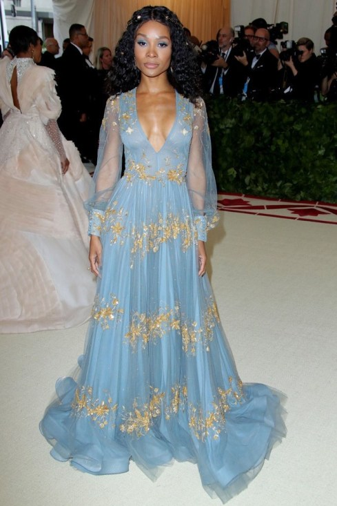 Zuri Hall on the red carpet wearing a blue and gold dress befitting of the heavenly bodies theme of the 2018 Met Gala