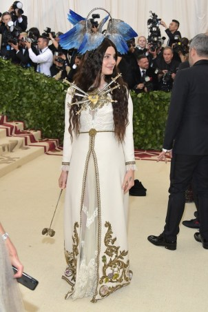 Lana Del Rey on the red carpet at the 2018 met gala wearing head to toe gucci