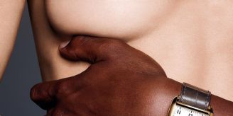 A close crop of a womans breast being covered by and hand and wrist showing the newly launched Tom ford 001 Timepiece. Fashion Voyeur