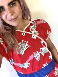 In a website photoshoot for vintage fashion retailer Trendlistr, blogger Pixie Tenenbaum wears a red deckchair print jumpsuit with elasticated waist