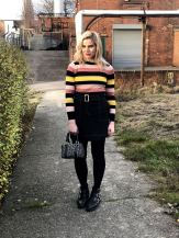 Fashion Blogger Pixie Tenenbaum wears an A-Line skirt and striped sweater from the Winter 2018 edit of Holly's Must Haves from Marks & Spencer with a Dior bag for Fashion Voyeur