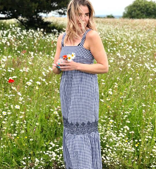 Blogger Pixie Tenenbaum wears a gingham maxi dress from the Marks and Spencer Summer 2019 collection