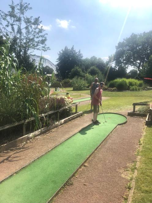 bo and Plankton Tenenbaum playing a round of Crazy Golf in the sunshine at Wicksteed Park