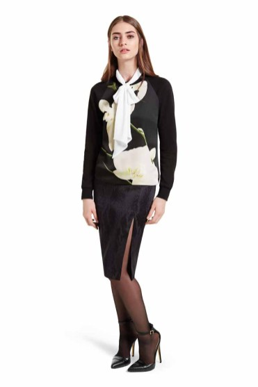 A balance of classically chic elements and bold contemporary style, this pairing makes a fashion forward statement. The romantic blouse is a striking match for the lux orchid print sweatshirt and pencil skirt with seductive slit. LOOK 12 Bow Blouse in Black/White, $29.99 Sweatshirt in Orchid Print, $29.99** Pencil Skirt in Black Jacquard, $34.99** Ankle Strap Shoe in Black, $39.99* *TARGET.COM EXCLUSIVE ** AVAILABLE GLOBALLY ON NET-A-PORTER.COM