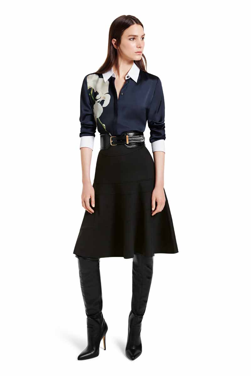 This work wear inspired shirt is paired with a flounce skirt and over-the-knee boots for a look of modern femininity. This outfit goes from day-to-night with ease. LOOK 13 Oxford Shirt in Navy Orchid Print, $34.99 Flounce Skirt in Black Pointe, $34.99 Croc Effect Belt in Black, $29.99** Over-the-Knee Boot in Black, $79.99 ** AVAILABLE GLOBALLY ON NET-A-PORTER.COM