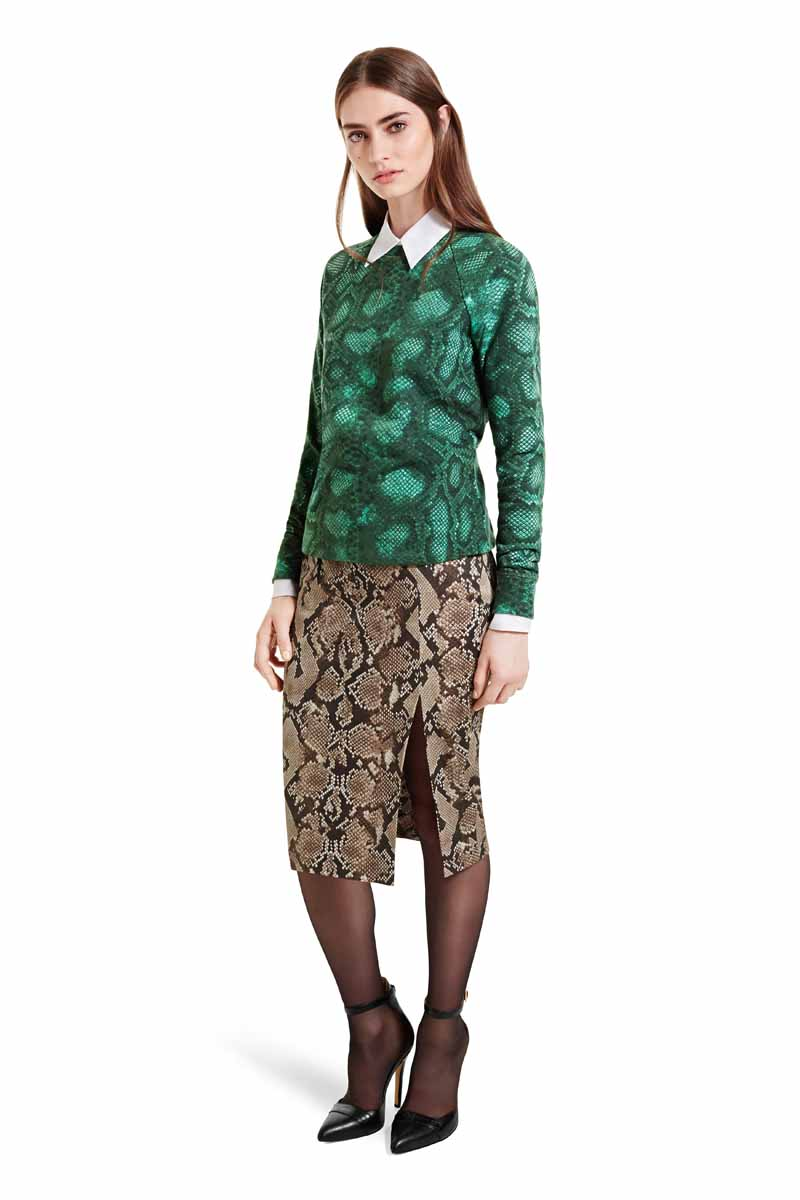 Mix bold prints to perfection with these simple separates. The clean lines of the pencil skirt and collar play off the laidback-lux sweatshirt and bold colors, for a fashion-forward style. LOOK 4 Sweatshirt in Green Python Print, $29.99* Oxford Shirt in Banker Stripe, $29.99** Pencil Skirt in Python Print, $34.99** Ankle Strap Shoe in Black, $39.99* ** AVAILABLE GLOBALLY ON NET-A-PORTER.COM