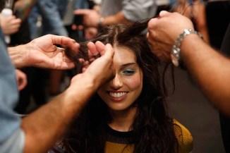 NEW YORK, NY - SEPTEMBER 07: A model prepares backstage for Tadashi Shoji fashion show at Gallery 1, Skylight Clarkson Sq on September 7, 2017 in New York City. (Photo by Thos Robinson/Getty Images For Tadashi Shoji)