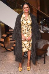 Donna D'Cruz in Max Mara grey feather coat and yellow print dress.