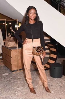 Genevieve Jones in Max Mara black long sleeve top and camel trousers.