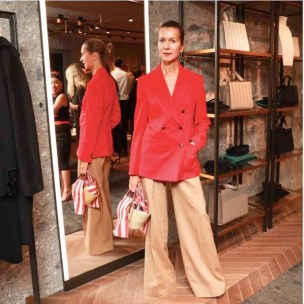 Natalie Joos In Max Mara red double-breasted blazer and camel trousers.