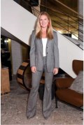 Sarah Arison in Max Mara grey suit.