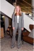 Sarah Arison in Max Mara grey suit.
