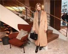 Xenia Van Der Woodsen in Max Mara camel coat and black bag.