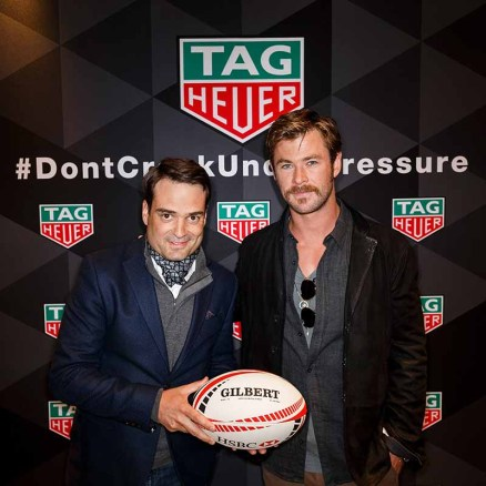 VANCOUVER, BC - MARCH 11: TAG Heuer President North America Kilian Muller (L) and TAG Heuer Ambassador Chris Hemsworth pose after TAG Heuer donates money to indigenous youth rugby programs at the 2018 Canada Sevens Rugby Tournament at BC Place on March 11, 2018 in Vancouver, Canada. (Photo by Andrew Chin/Getty Images for TAG Heuer)