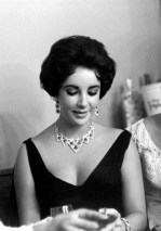 Elizabeth Taylor wearing her Cartier ruby and diamond necklace and earrings in Las Vegas, 1958, © Photofest