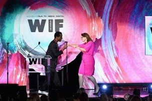 BEVERLY HILLS, CA - JUNE 13: Honoree Victoria Alonso accepts The Lexus Beacon Award from Isaach de Bankole onstage during the Women In Film 2018 Crystal + Lucy Awards presented by Max Mara,Lancôme and Lexus at The Beverly Hilton Hotel on June 13, 2018 in Beverly Hills, California. (Photo by Emma McIntyre/Getty Images for Women In Film)